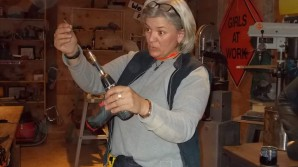 Elaine Hamel, seen here at the Goffstown-based nonprofit Girls at Work, says at-risk young girls can find inner strength and confidence by mastering power tools and building things of value out of wood. (COURTESY)